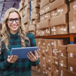 female warehouse employee doing inventory