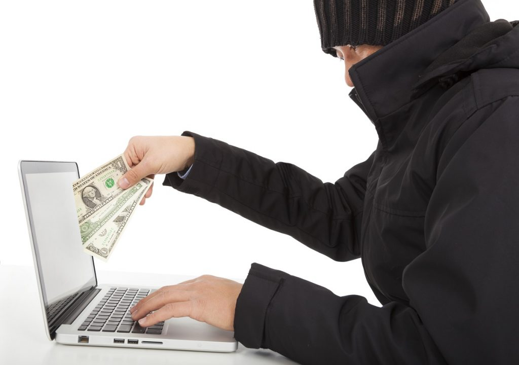 Hacker holding money