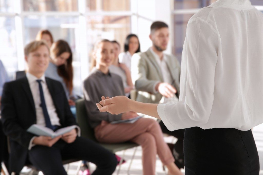 Speaker in front of employees being trained
