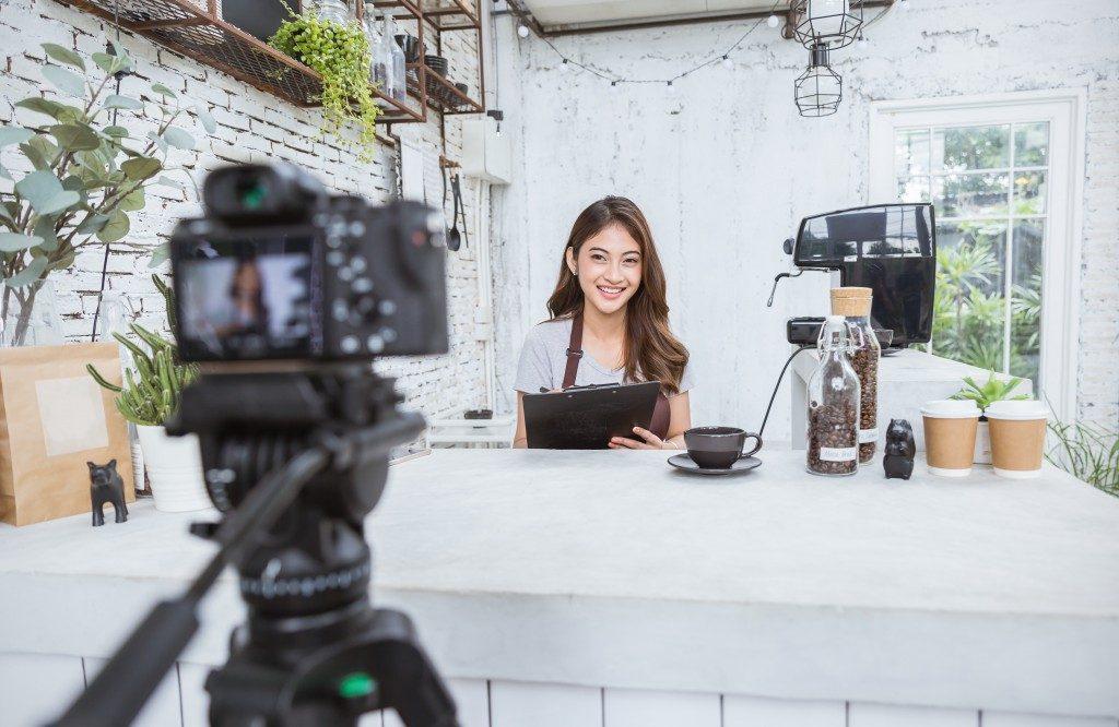A food blogger facing the camera